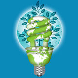 Energy Saving Eco Lightbulb with World Globe. On Blue Background Royalty Free Stock Images