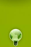 Energy saving ecologic friendly light bulb earth. An energy saving and ecological depiction of the earth in the form of a light bulb Stock Photography
