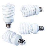 Energy-saving fluorescent lamp isolate on a white background, from different angles, closeup. Royalty Free Stock Image