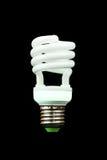 Energy saving fluorescent light bulb. Isolated on  black Stock Photography