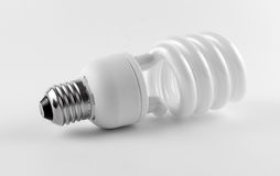 Energy saving fluorescent light bulb on white background Royalty Free Stock Images