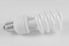 Energy saving fluorescent light bulb on white bakground Stock Photos