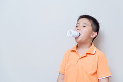Energy saving lamp in Asian boy mouth Stock Photos