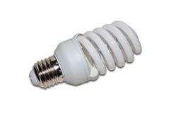 Energy saving lamp. Closeup isolated on white background Stock Images