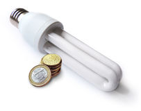 Energy saving lamp and coins Royalty Free Stock Photo