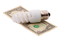 Energy saving lamp and dollar Royalty Free Stock Images