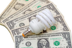 Energy saving lamp on the dollar Royalty Free Stock Photos
