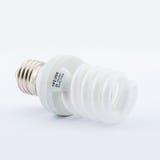 Energy Saving lamp. Energy Saving Fluorescent Lightbulb Isolated on White Background stock photo