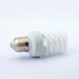 Energy Saving lamp. Energy Saving Fluorescent Lightbulb Isolated on White Background royalty free stock image