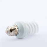 Energy Saving lamp. Energy Saving Fluorescent Lightbulb Isolated on White Background royalty free stock photos