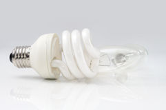 Energy saving lamp in front of an ordinary lamps Stock Image
