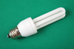 Energy-saving lamp on green Royalty Free Stock Photo