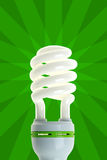 Energy Saving Lamp on Green. Compact fluorescent energy saving environment friendly bulb on green background stock photography