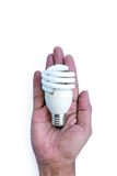 Energy saving lamp in hand stock image