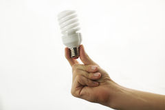 Energy-saving lamp in hand royalty free stock photos