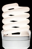 Energy saving lamp. Isolated on black backgroundn royalty free stock photos