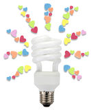 Energy saving lamp light heart. Royalty Free Stock Photos