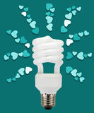 Energy saving lamp light heart. Royalty Free Stock Photography