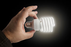 Energy saving lamp in the man's hand Royalty Free Stock Photo