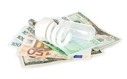 Energy saving lamp and money Stock Photo