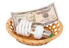 Energy saving lamp and money Stock Image