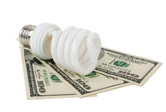 Energy saving lamp and money Royalty Free Stock Photography