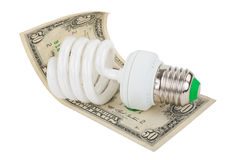 Energy saving lamp and money Stock Photography