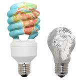 Energy saving lamp and normal lamp. Energy saving lamp in color and normal lamp in black and white performance. On the bulb earth surface. Isolated object Stock Images