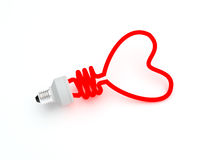 Energy saving lamp in the shape of the heart. Isolated Royalty Free Stock Photography