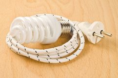 Energy saving lamp. On wooden background royalty free stock images