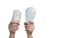 Energy-saving lampen in de handen van kinderen Royalty-vrije Stock Foto's