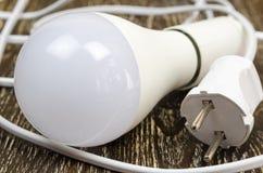Energy saving led light bulb on wooden background. Royalty Free Stock Image