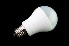Energy saving LED light bulbs on the black background. Stock Image