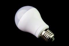 Energy saving LED light bulbs on the black background. Stock Images