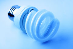 Energy Saving Light Bulb. With cool blue color Stock Image