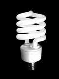 Energy-saving light bulb. A closeup of an energy-saving light bulb isolated on black royalty free stock photography