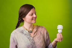 Energy saving light bulb. An environmentalist holds a compact fluorescent light bulb Royalty Free Stock Photo