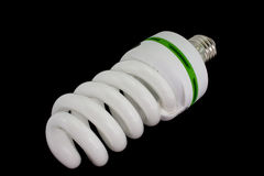 Energy-saving light bulb. Change the world with changing a few light bulbs. Isolated On Black Royalty Free Stock Images