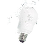 An energy saving light bulb falling into the water Stock Image