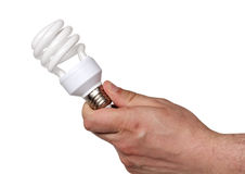Energy saving light bulb in hand Royalty Free Stock Photos