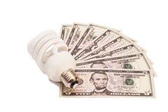 Energy saving light bulb and money Stock Image
