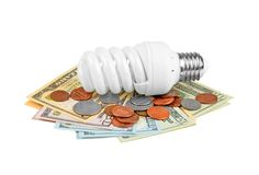 Energy saving light bulb and money Royalty Free Stock Photo