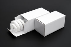 Energy saving light bulb in an opened box with one box closed Royalty Free Stock Photo