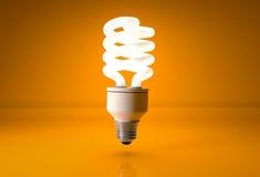 Energy saving light bulb on orange background. Eco energy saving light bulb on orange background Stock Photos