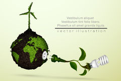Energy saving light bulb. With a plug and green leaves, grass and the planet concept of ecology and clean energy Stock Image