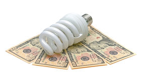Energy saving light bulb and U.S. dollars Royalty Free Stock Images