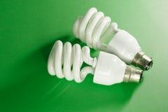 Energy saving light bulbs. On green background Royalty Free Stock Photos