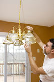 Energy saving light bulbs. Home owner install energy saving light bulbs in dining room,bathrooms & kitchen to save energy & money Stock Images