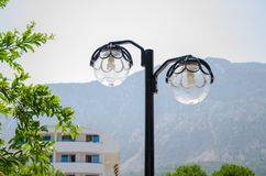 Energy-saving light bulbs in the lantern on the nature near the mountains stock photos