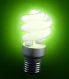 Energy saving lightbulb. An energy saving lightbulb shinging green light Stock Image